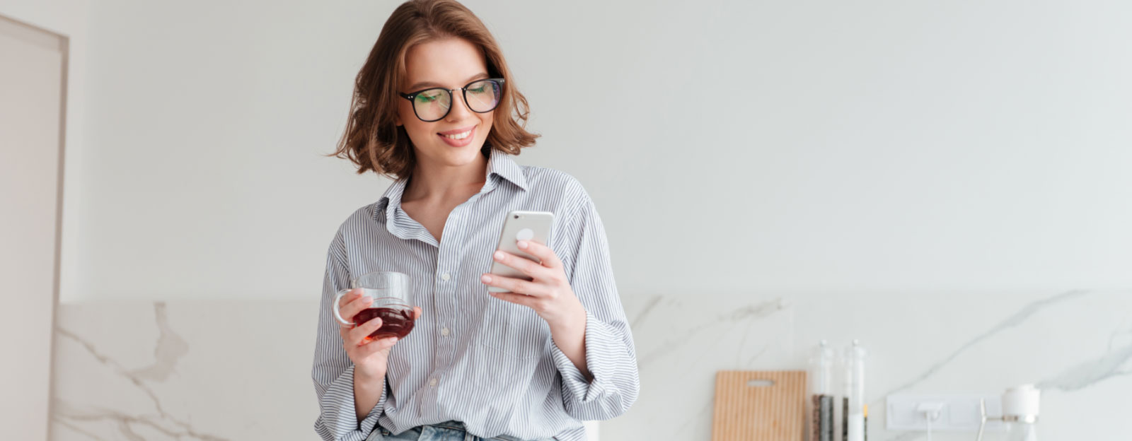 Lady checking her phone for job alerts